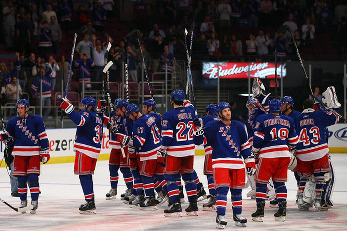 The New York Rangers celebrate after an overtime preseason win against the New Jersey Devils at Madison Square Garden on September 23 2010 in New York City. The Rangers defeated the Devils 4-3.  (Photo by Andrew Burton/Getty Images)