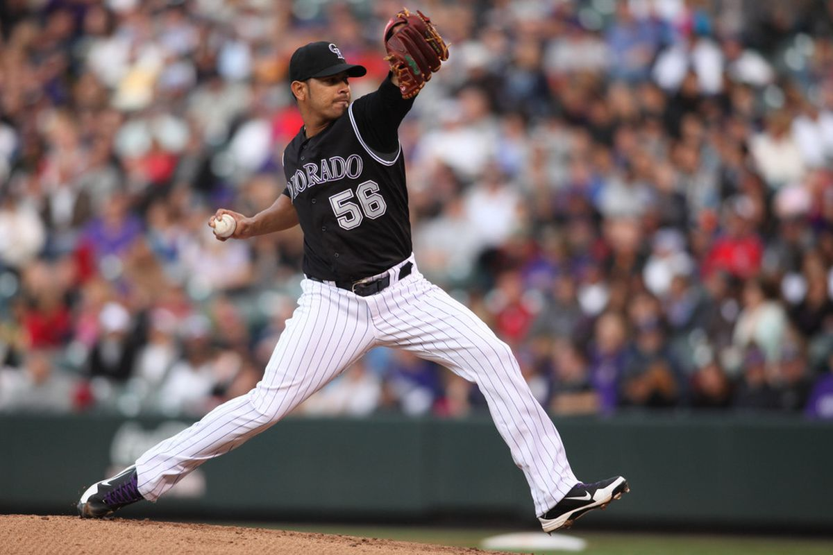 April 28, 2012; Denver, CO, USA; Colorado Rockies pitcher Guillermo Moscoso (56) delivers a pitch during the first inning against the New York Mets at Coors Field.  Mandatory Credit: Chris Humphreys-US PRESSWIRE