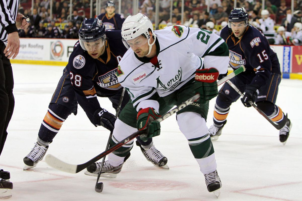 <strong>Chad Rau battles for the puck. </strong><em>Photo by Morris Molina/Houston Aeros</em>