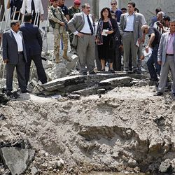 Iraqi Foreign Minister Hoshyar Zebari, center, inspects damage to the ministry complex after a bombing in Baghdad, Iraq Saturday. Zebari said Saturday that those who carried out bombings that targeted government buildings in the Iraqi capital received help to pull off the attacks, possibly from Iraqi security forces.