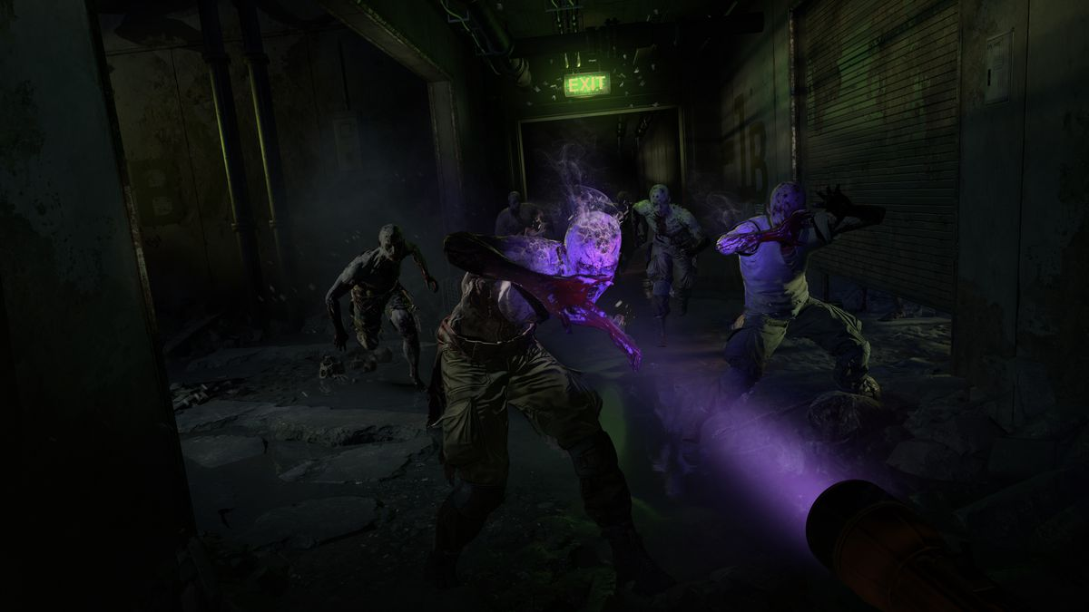 A player in first-person points a purple light at zombies in a screenshot from Dying Light 2