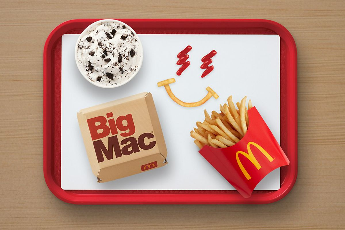 An overhead shot of a red tray with a Big Mac, fries, and an oreo mcflurry