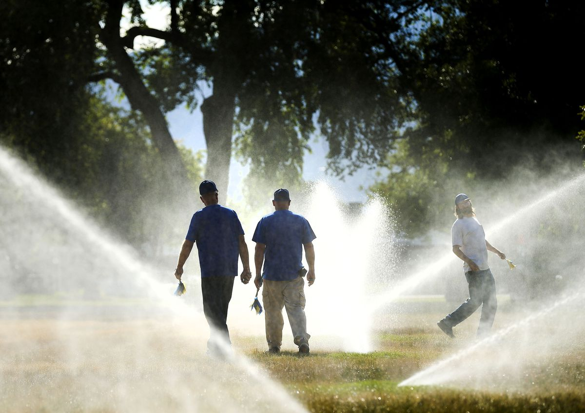 Irrigation specialists Dan Waters, left, Dan Lloyd and Kenneth Rands check for broken sprinkler heads at Salt Lake Community College in Taylorsville on Thursday, July 1, 2021. Overall, irrigated water use has decreased by 31% at the Redwood campus, where there are more than 60 acres of irrigated landscape, with more than 950 individual sprinkler zones.