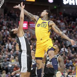 Utah Jazz guard Jordan Clarkson (00) shoots over San Antonio Spurs guard Bryn Forbes (11) during an NBA game at Vivint Arena in Salt Lake City on Friday, Feb. 21, 2020. The Jazz lost 104-113.