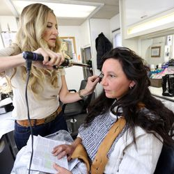 Becky Swasey does hair and makeup for Kymberly Mellen, who plays Sariah, on the set of the Book of Mormon Visual Library at LDS Motion Picture Studios South Campus near Goshen on Friday, July 7, 2017.
