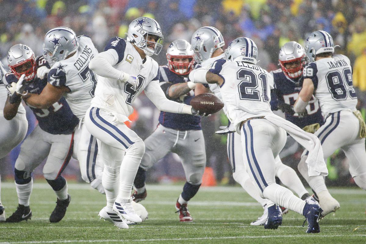 Dallas Cowboys quarterback Dak Prescott hands off the ball to running back Ezekiel Elliott during the second half against the New England Patriots at Gillette Stadium.