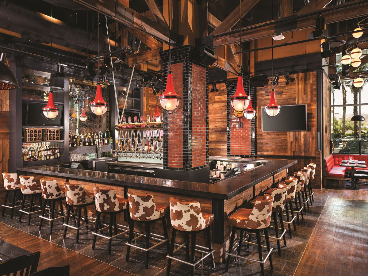 The interior of a bar with wood floors