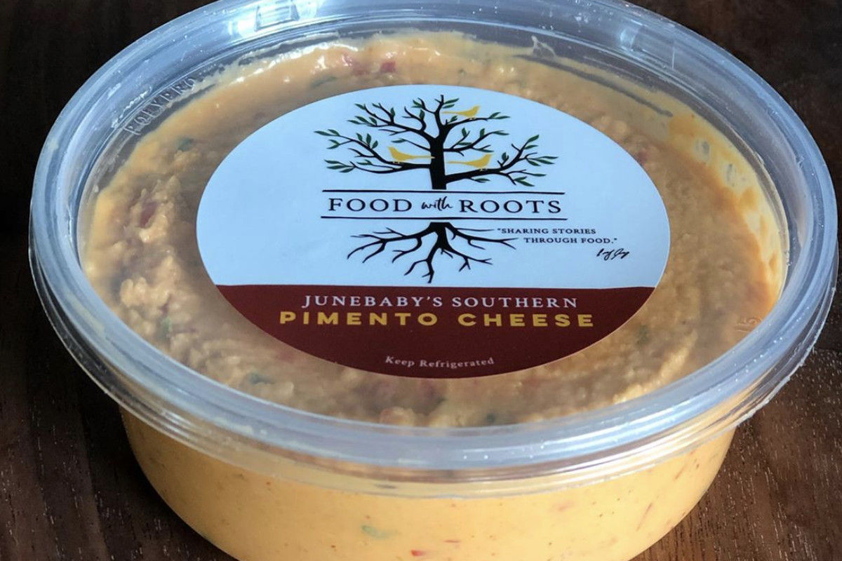 A container of pimento cheese spread from Edouardo Jordan's Food with Roots
