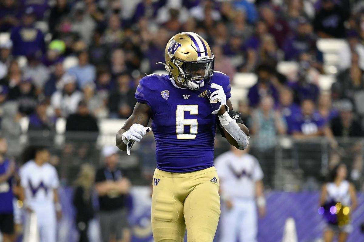 Richard Newton of the Washington Huskies walks on the field during the second half of the game against the Montana Grizzlies at Husky Stadium on September 4, 2021 in Seattle, Washington. The Grizzlies won 13-7.