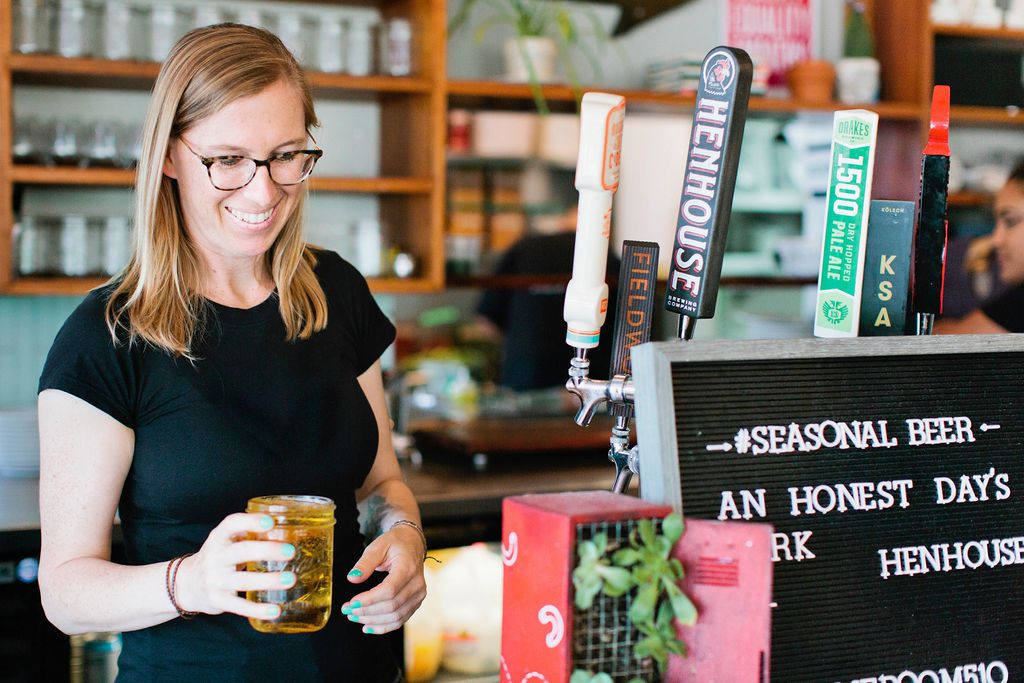 Erin Wade pouring a beer at Homeroom