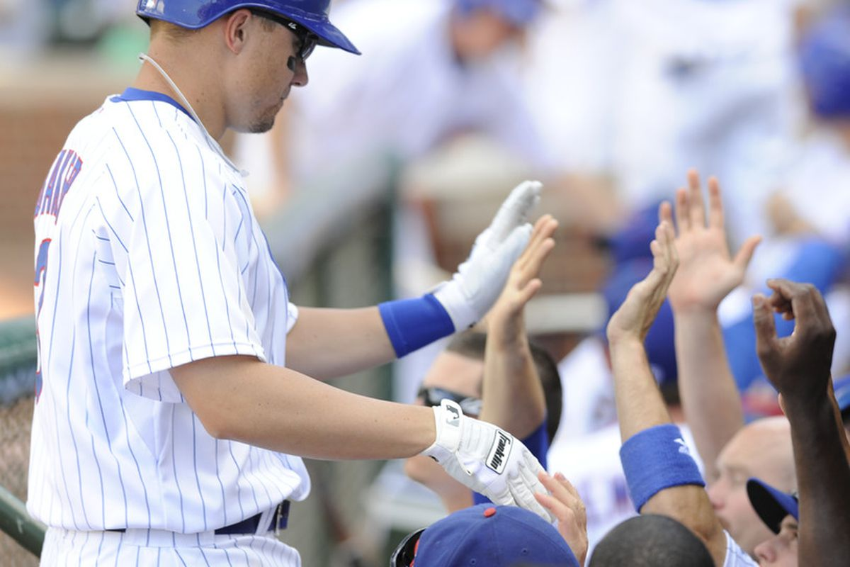 Jeff Baker of the Chicago Cubs gets high fives after hitting an RBI single against the San Diego Padres at Wrigley Field in Chicago, Illinois. The Chicago Cubs defeated the San Diego Padres 5-3. (Photo by David Banks/Getty Images)