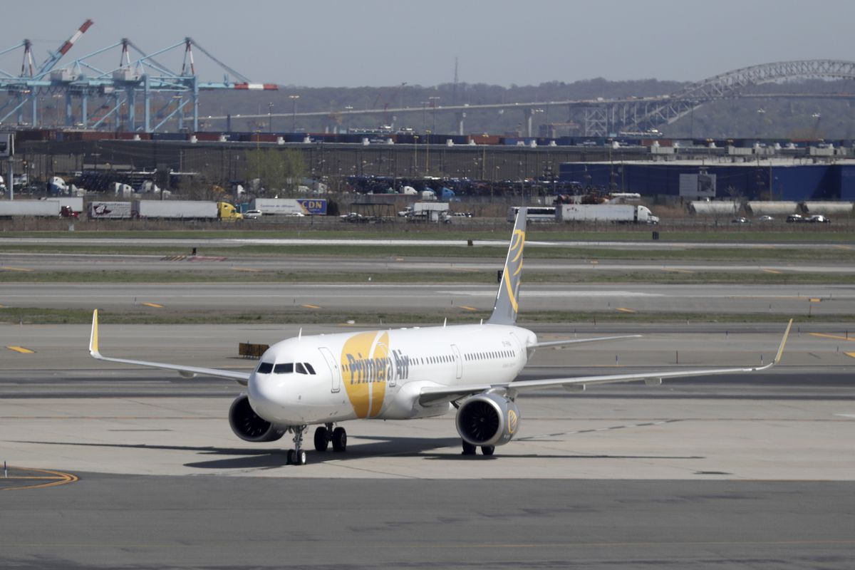 A charter jet for Primera Air taxis at Newark Liberty International Airport, Wednesday, May 2, 2018, in Newark, N.J.
