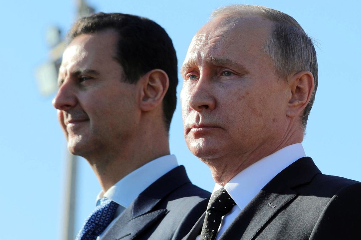 FILE - This Monday, Dec. 11, 2017 file photo, Russian President Vladimir Putin, right, and Syrian President Bashar Assad watch the troops marching at the Hemeimeem air base in Syria. Nearly seven years into the conflict, the war in Syria seems on one leve
