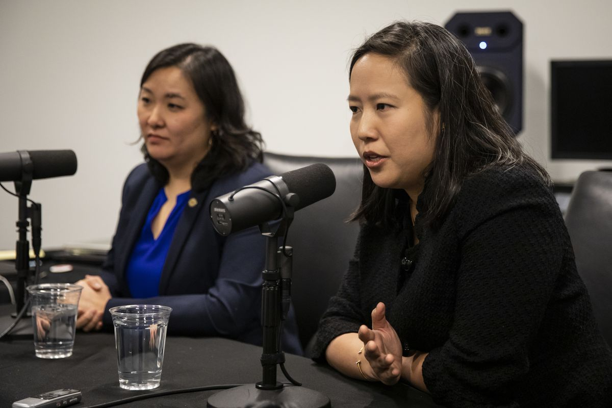 City Budget Director Susie Park (left) and Chief Financial Officer Jennie Huang Bennett (right) talk to Sun-Times City Hall reporter Fran Spielman on Friday.