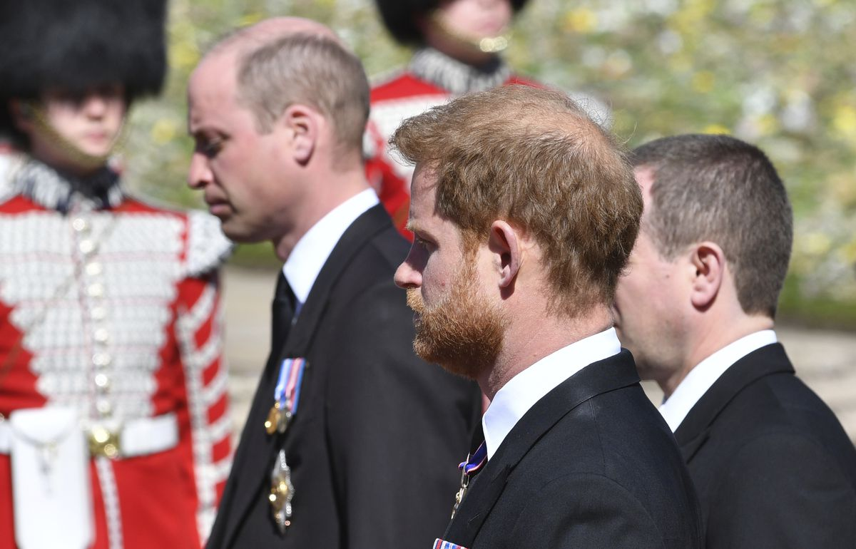 Prince William and Prince Harry follow the coffin during a procession arriving at St George's Chapel for the funeral of Britain's Prince Philip inside Windsor Castle in Windsor, England, Saturday, April 17, 2021.