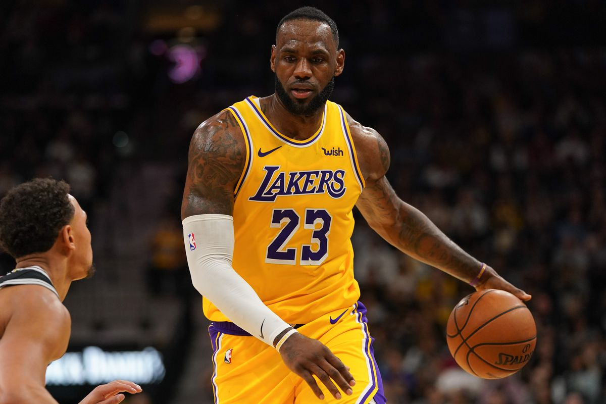 Los Angeles Lakers forward LeBron James dribbles in front of San Antonio Spurs guard Bryn Forbes in the second half at the AT&T Center.