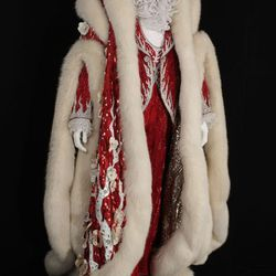 Christmas cape: In 1980, Liberace wore this gabardine and white fox cape for his Christmas appearances at the Las Vegas Hilton and then again at Radio City Music Hall in 1985. The cape demonstrates the skill of Anna Nateece, a Greek-born master furrier wh