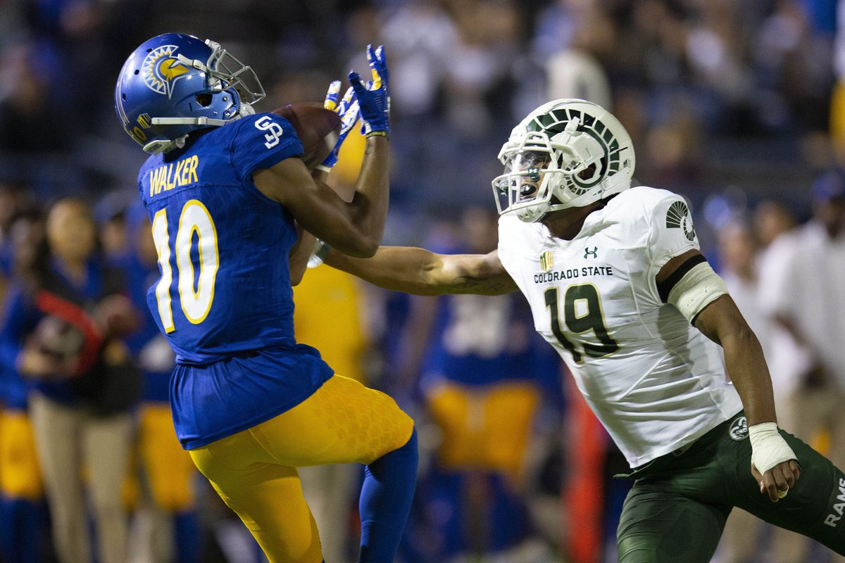 San Jose State wide receiver Tre Walker catches a deep pass in front of Colorado State Rams defensive back V.J. Banks during the third quarter of an NCAA football game.