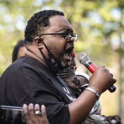 Jacob Blake's father, also Jacob Blake, speaks to a crowd of more than a thousand during a rally in Civic Center Park in downtown Kenosha, six days after his son was shot in the back by a police officer in the Wisconsin city, Saturday, Aug. 29, 2020.