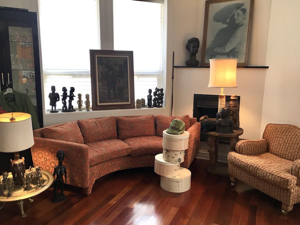 All of the furniture and art in the family's great room, anchored by a curved Dunbar couch, are available in the Claude Barnett and Etta Moten Barnett estate sale being handled by Estate Sale Goddess.