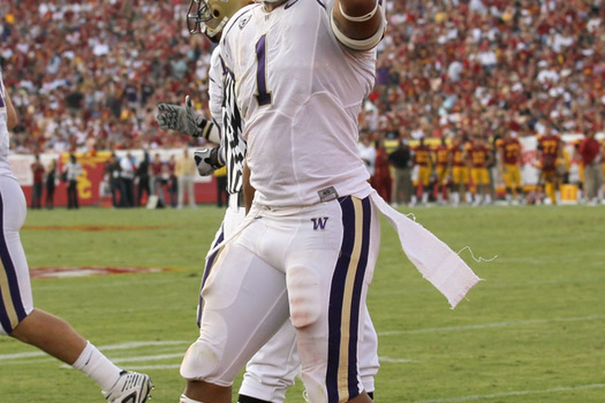 LOS ANGELES CA - Running back Chris Polk #1  of the Washington Huskies celebrates his second quarter touchdown against the USC Trojans at the Los Angeles Memorial Coliseum. (Photo by Stephen Dunn/Getty Images)