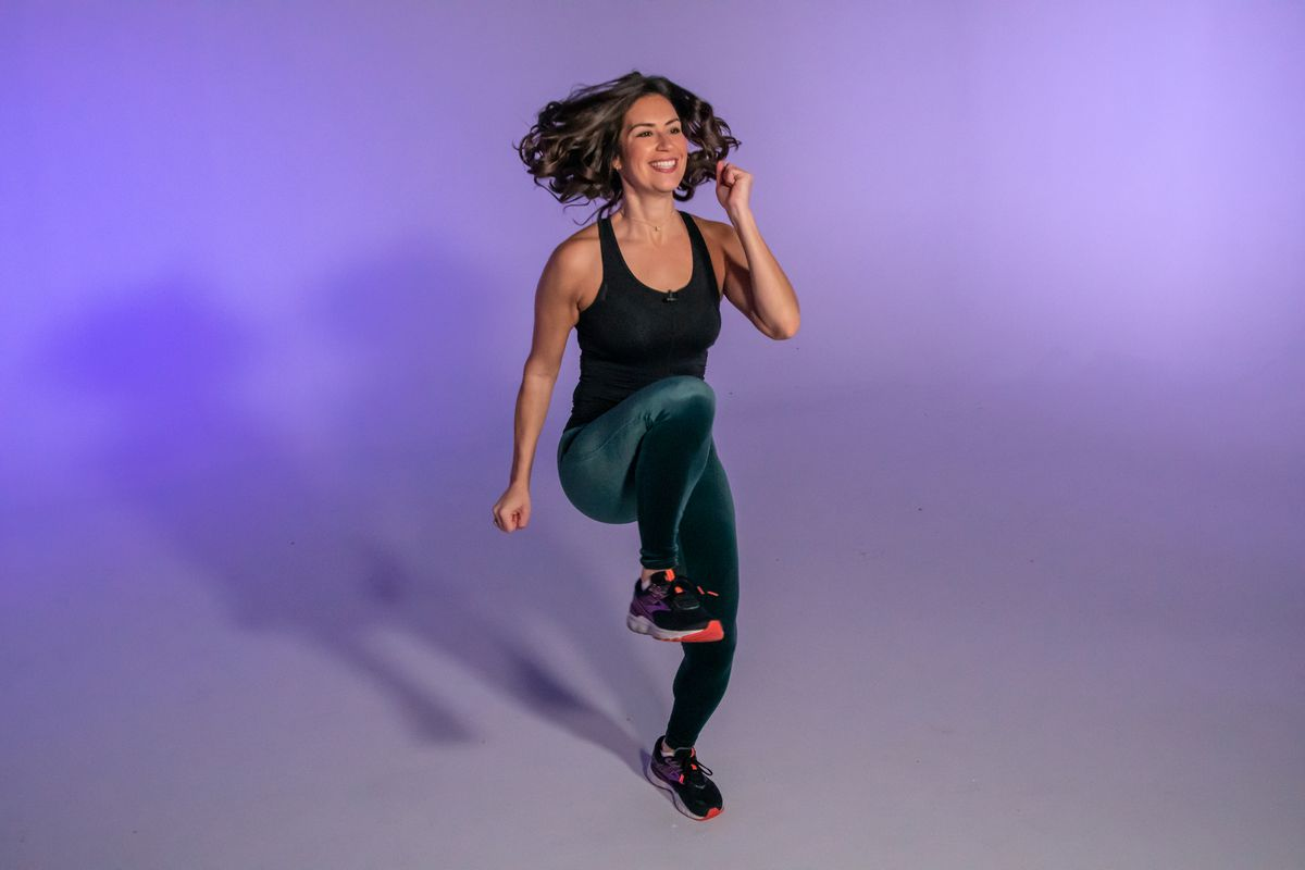 Stephanie Mansour demonstrates high knees, which is part of her cardio detox workout.