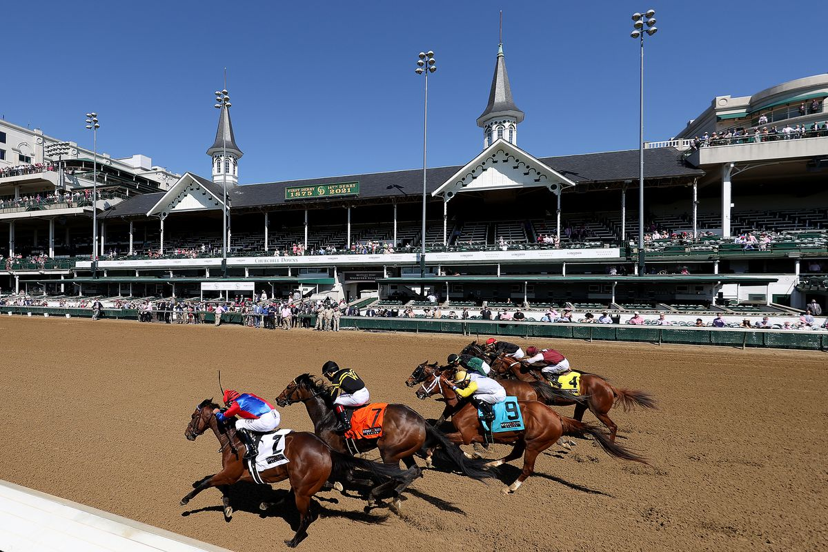 Horses head to the finish line during the second race of the day prior to the running of the 2021 Kentucky Oaks at Churchill Downs on April 30, 2021 in Louisville, Kentucky.