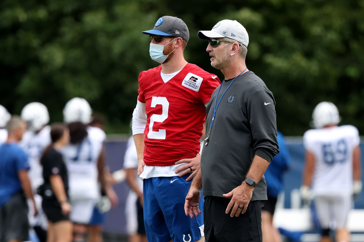 Head coach Frank Reich and Carson Wentz #2 of the Indianapolis Colts talk on the field during the Carolina Panthers and Indianapolis Colts joint practice at Grand Park on August 12, 2021 in Westfield, Indiana.