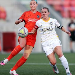 Houston Dash defender Erin Simon (17) tries to keep Utah Royals FC forward Amy Rodriguez (8) from getting around to the ball as the Utah Royals and the Houston Dash play in the Challenge Cup quarterfinals at Zions Bank Stadium in Herriman Utah on Friday, July 17, 2020.