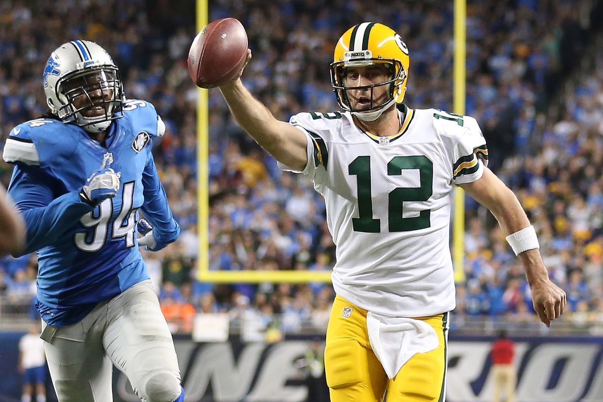 Aaron Rodgers #12 of the Green Bay Packers runs the ball for a fourth quarter touchdown against the Detroit Lions on December 3 2015 at Ford Field in Detroit, Michigan.