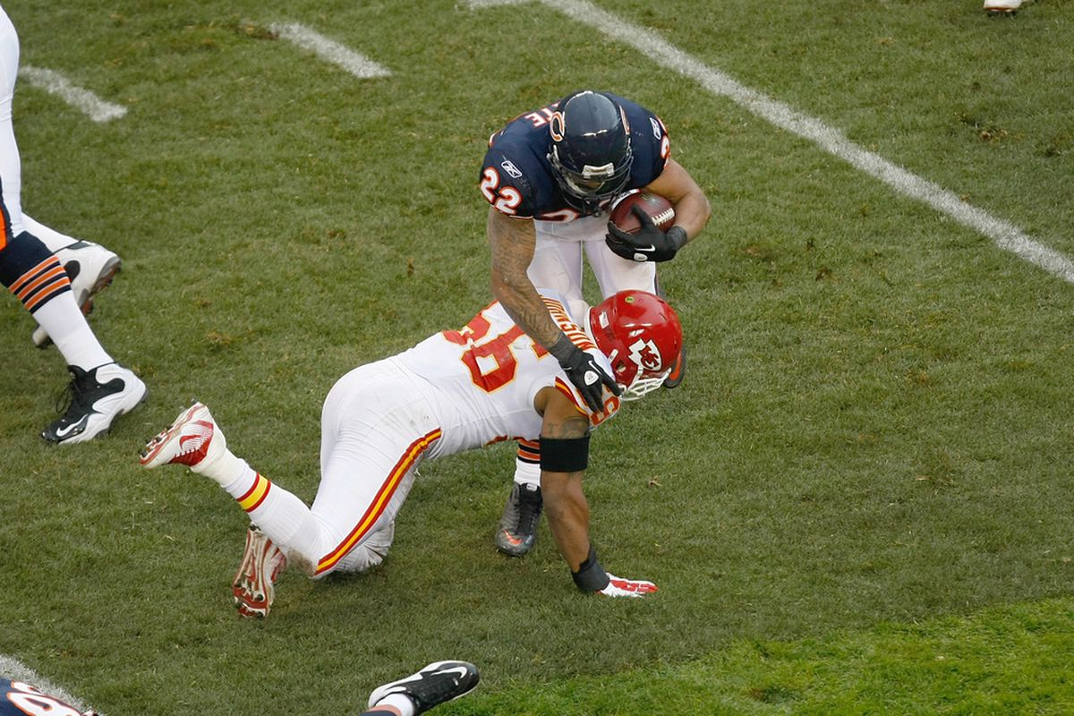 CHICAGO, IL - DECEMBER 4: Matt Forte #22 of the Chicago Bears is hit by  Derrick Johnson #56 of the Kansas City Chiefs at Soldier Field on December 4, 2011 in Chicago, Illinois. (Photo by Scott Boehm/Getty Images)