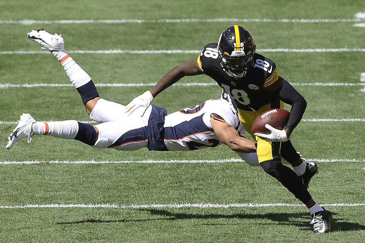 Pittsburgh Steelers wide receiver Diontae Johnson (18) runs after a catch as Denver Broncos cornerback Bryce Callahan (rear) defends during the second quarter at Heinz Field.