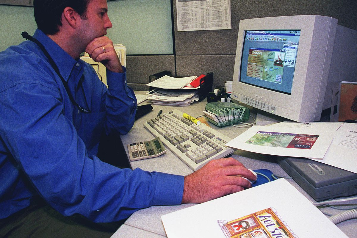 Peter Whelan checks the AOL shopping home page in 1997