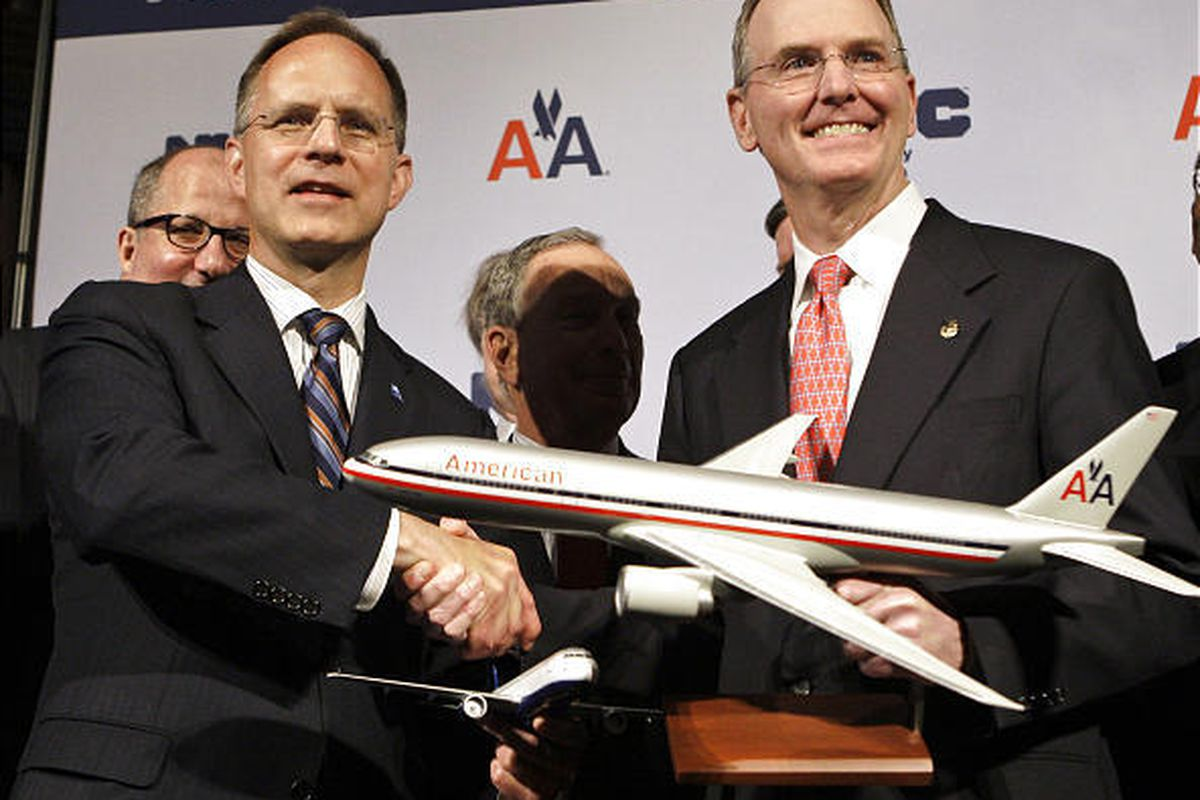 JetBlue CEO Dave Barger, left, shakes hands with American Airlines CEO Gerard Arpey Wednesday.