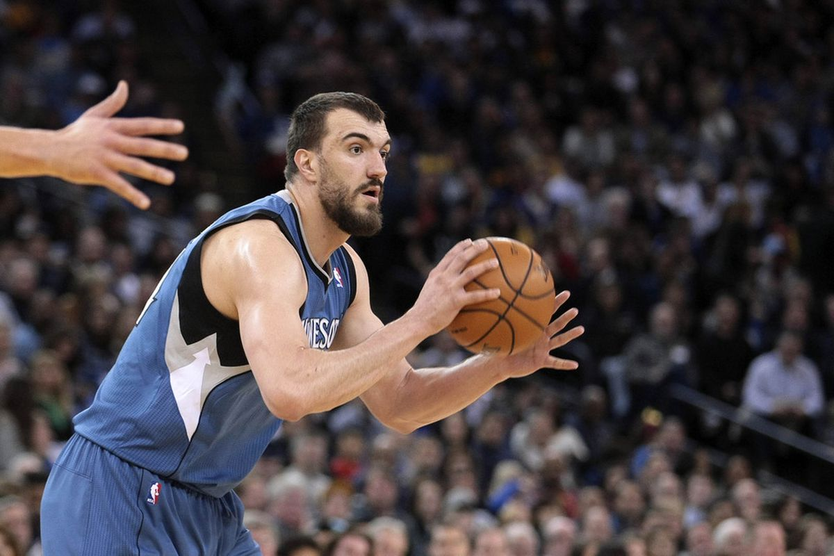 March 19, 2012; Oakland, CA, USA; Minnesota Timberwolves center Nikola Pekovic (14) passes the ball against the Golden State Warriors during the first quarter at Oracle Arena. Mandatory Credit: Kelley L Cox-US PRESSWIRE