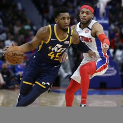 Utah Jazz guard Donovan Mitchell (45) drives against Detroit Pistons guard Bruce Brown (6) during the second half of an NBA basketball game Saturday, March 7, 2020, in Detroit.