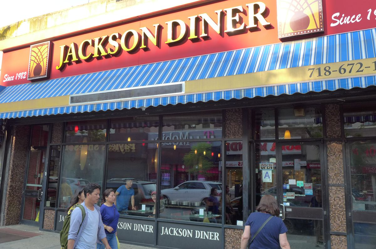 The exterior of Jackson Diner with a bright red marquee