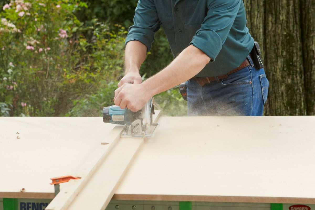 Cutting Wood With Circular Saw To Make Room Divider