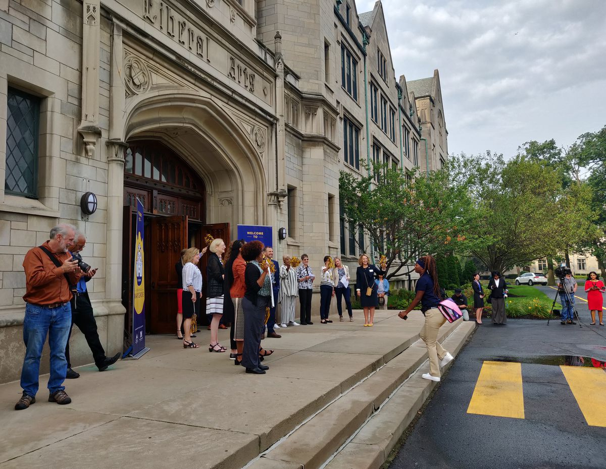 Students walk into the School at Marygrove on its first day.