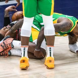 Utah Jazz and Portland Trail Blazer players collide during the game at Vivint Smart Home Arena in Salt Lake City on Thursday, April 8, 2021.