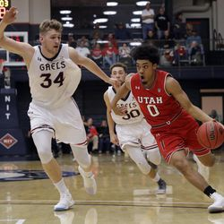 Utah guard Sedrick Barefield (0) dribbles past Saint Mary's center Jock Landale (34) during the first half of an NCAA college basketball game in the quarterfinals of the NIT, Wednesday, March 21, 2018, in Moraga, Calif. (AP Photo/Marcio Jose Sanchez)