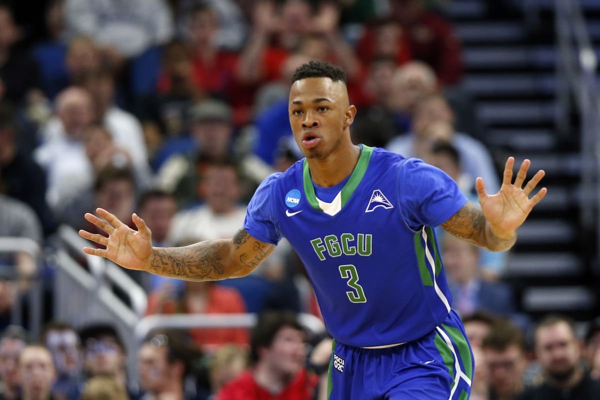 Florida Gulf Coast Eagles guard Rayjon Tucker reacts after dunking against the Florida State Seminoles during the first half in the first round of the NCAA Tournament at Amway Center.