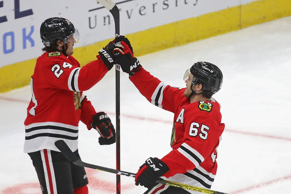 Andrew Shaw (right, No. 65) uses his jovial personality to boost the Blackhawks' camaraderie.