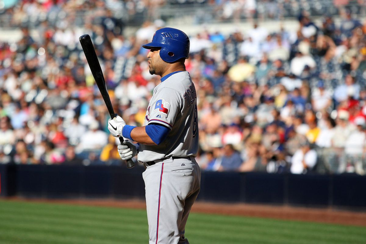 June 20, 2012; San Diego, CA, USA; Texas Rangers catcher Yorvit Torrealba (8) during a sixth inning at bat against the San Diego Padres at PETCO Park. Mandatory Credit: Jake Roth-US PRESSWIRE