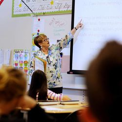 Substitute teacher Patrice Cullimore works with a class Monday, March 30, 2015, at Endeavour Elementary in Kaysville.
