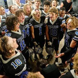 Stansbury players perform a celebratory team song after winning a high school football game against Tooeleat Stansbury High School in Stansbury Park on Friday, Sept. 17, 2021.