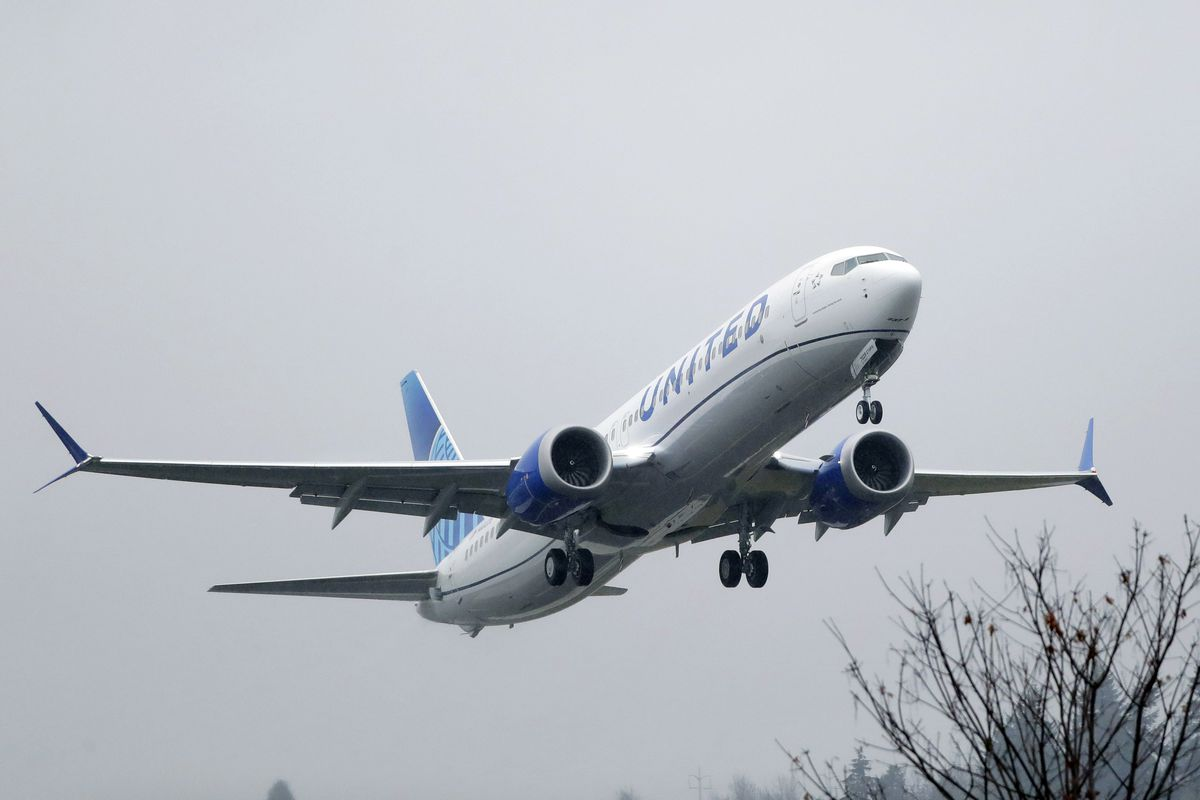 an United Airlines Boeing 737 Max airplane takes off in the rain at Renton Municipal Airport in Renton, Wash.
