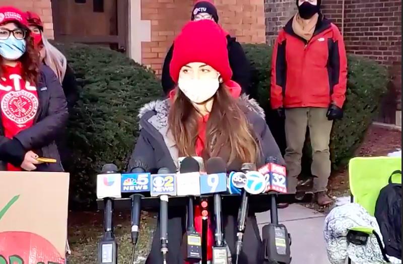 Sol Camano, a Chicago preschool teacher, speaks outside the school board president's house on Jan. 13, 2021.