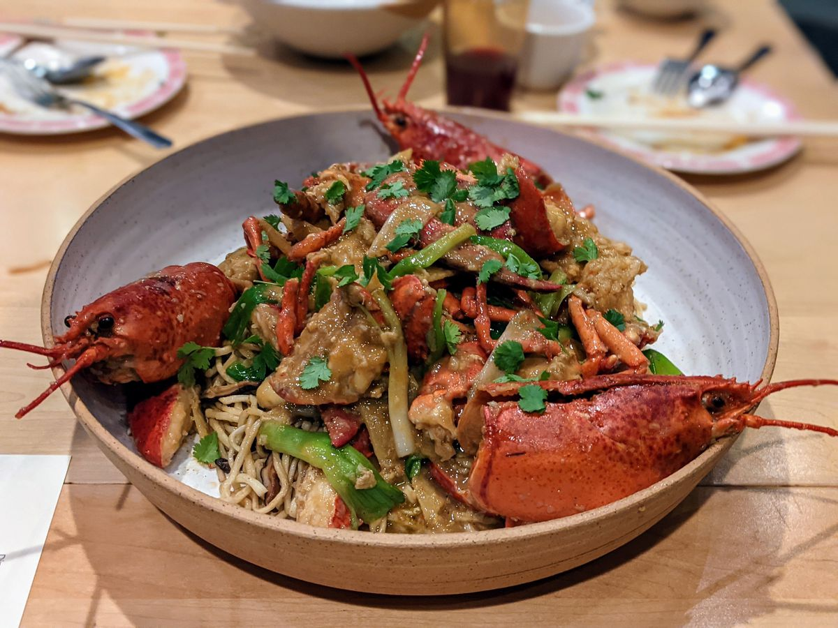 Lobster noodles from Needle in a large ceramic bowl.