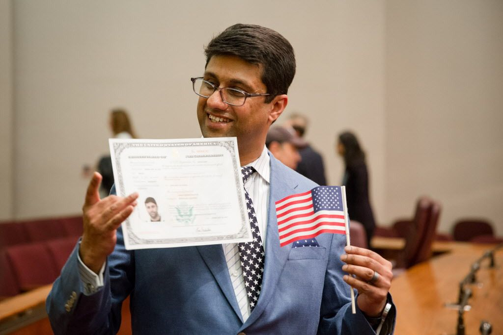 Farac Baluch, born in Pakistan, became a U.S. citizen at a naturalization ceremony Monday at Chicago City Hall.   Santiago Covarrubias/For the Sun-Times